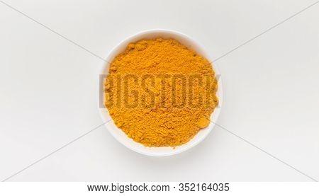 Turmeric Powder, Curcumin, Curcuma Longa Linn In Ceramic Plate On White Background., Panorama