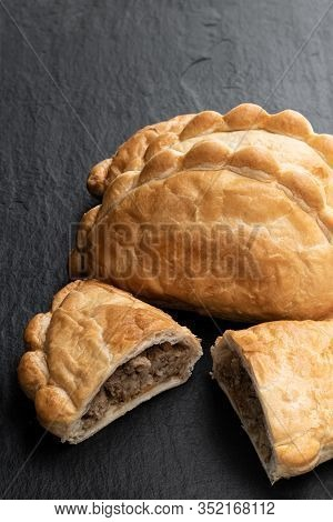Homemade  Flaky Pasty With Mince Meat Filling On Black Stone Background