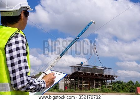 The Inspectors Or Engineers Are Checking The Work Of The Contractor Team To Build A Bridge Over The