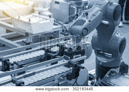 The Hi-technology  Material Handing Process In By Robotics System. The Modern Technology For Automat
