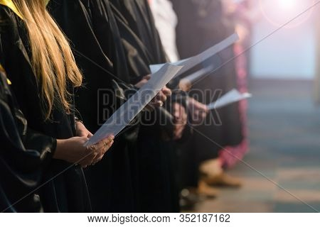 Choir Singers Holding Musical Score And Singing On Student Graduation Day In University, College Dip