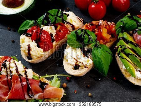Assorted Bruschetta With Various Toppings.appetizing Bruschetta.variety Of Small Sandwiches.mix Brus