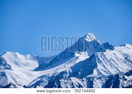 Snow Covered Mountains With Blue Sky From Namgyal Tsemo Gompa In Leh, Ladakh Region, India.