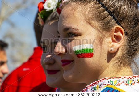 Varvara, Bulgaria - March 24, 2019: The Bulgarian Flag Painted On The Face Of A Beautiful Smiling Bu