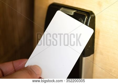 Hand Using Electronic Smart Contactless Key Card For Unlock Door In Hotel Or House.