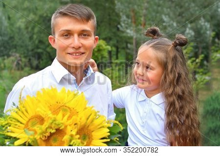 A Bouquet For First Beloved Teacher On First Of September. Flowers For The Last Bell. Day Of Knowled