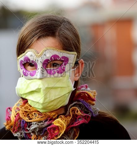 Young Girl With Health Mask And Carnival Mask For Protection Against The Virus Crown