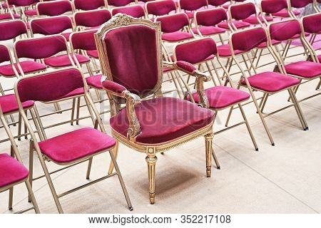 Unique Throne Or Ceremonial Armchair With Velvet Seat And Golden Details Among Many Simple Identical