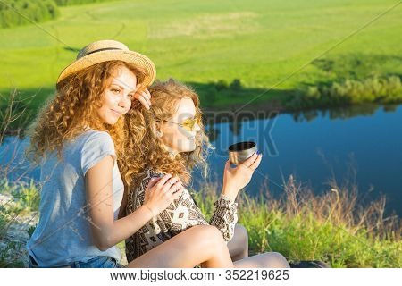 A World Without Borders. Stunning Journey Of Two Girls In The Mountains. Happy Traveler Young Couple