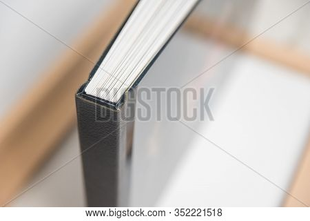 Close Up View Of Photo Album Book Binding - Spine View Of Block