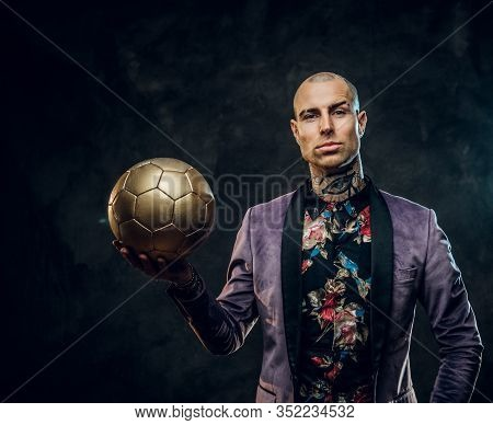 Vivid, Successfull, Tattooed, Bald Male Model Posing In A Studio For The Photoshoot Wearing Fashiona