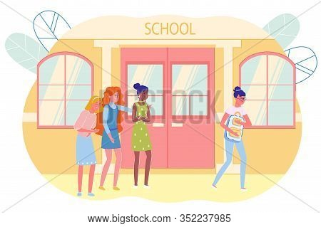 Popular Girls Laughing At Classmate In Hallway. Friends Point Fingers, Mock And Gossip Over Lonely G