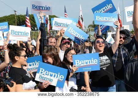 SANTA ANA, CALIFORNIA - 21 FEB 2020: Bernie Sanders Rally. Closeup of a group of supporters holding their signs at an outdoor rally.