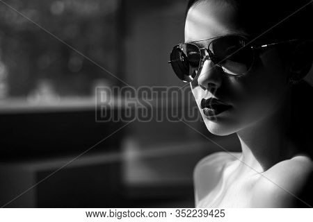 Female Fashion Model Posing With Sunglasses. Sexy. Close-up Portrait Of A Beautiful Charming Young A