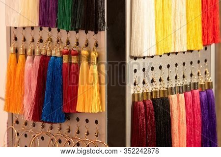 Set Of Colorful Tassels. Close Up Tassels Of Various Colors.