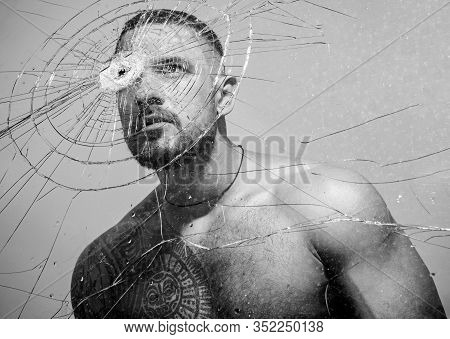 Power And Vitality. Latino Man Full Of Power And Energy Looking Through Broken Glass. Strong Hispani