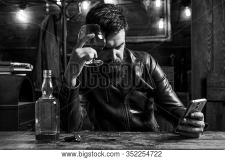 Drinking And Party Concept. Man Drinks Brandy Or Whiskey. Bearded Man Wearing Suit And Drinking Whis