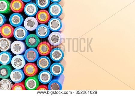 Close Up Of Colorful Used Rechargeable Nickel Metal Hydride (ni-mh) Battery On Beige Background, Fla