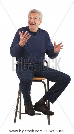 Happy Senior Man Shrugs Cheerfully