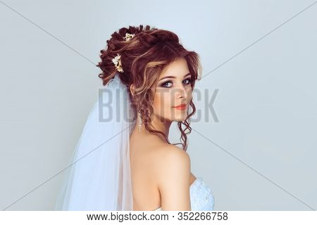 Spouse Looking Back. Beautiful Young Bride. Stylish Woman Fiancee With Bridal Hairstyle, Event Makeu