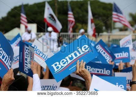 SANTA ANA, California / USA - February 21, 2010: People wave Bernie Signs, Wave, Smile during a Bernie Sanders for President Rally. Editorial Use Only.