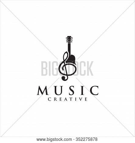 Guitar Music Note Logo Vector Illustration . Note Guitar Logo Vector Illustration Design . Music Log