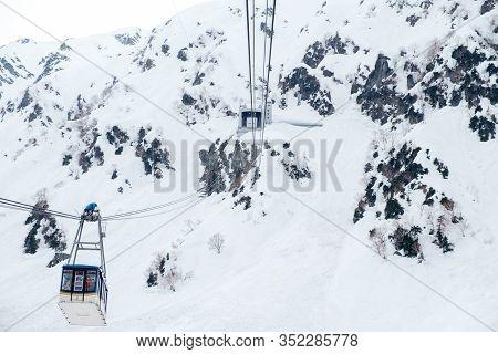 Cable Car At Tateyama Kurobe Alpine Snow Mountain,repairman Or Maintenance Man On Top Of Airline Cab