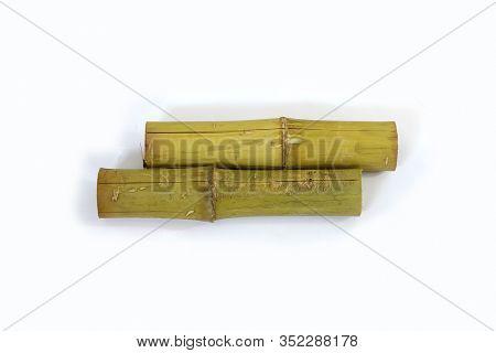 Khao Lam Rice Wood Stick Isolated On White Background. Thai Food Style.