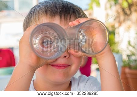 Boy Looking Through Two Glasses. Smiling Boy. Funny Kid Joking. Summer Vacation. Waiting For Order A