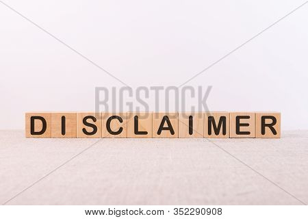 Disclaimer Word Made With Building Blocks On A Light Background