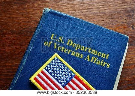 United States Us Department Of Veterans Affairs Va Book And Flag.