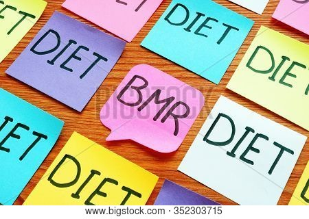 Bmr Basal Metabolic Rate And Diet Signs On The Memo Sticks.