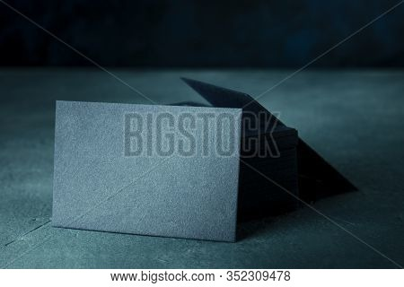 Business Cards, A Blank Mock-up For A Stack Of Dark Blue Thick Cardboard Cards On A Dark Backgroud W