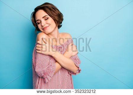Photo Of Pretty Lady Dreamer Hug Herself Enjoy Own Company Eyes Closed Peaceful Good Mood Wear Casua