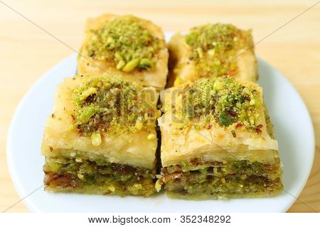 Closeup A Plate Of Delectable Square Shaped Baklava Pastries