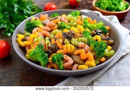 Cavatappi Colored Pasta With Broccoli And Mushrooms. Pasta Colorata. Pasta With Vegetables.