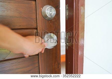 Hand Open Wooden Door Knob Show Inside Modern Bedroom