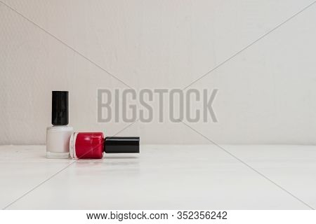 Red And White Nail Polish Isolated With Copy Space.