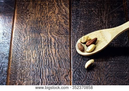 Brazil Nuts In Shell, Grown In Brazil And Bolivia. Chestnut Exported Worldwide. Space For Text.