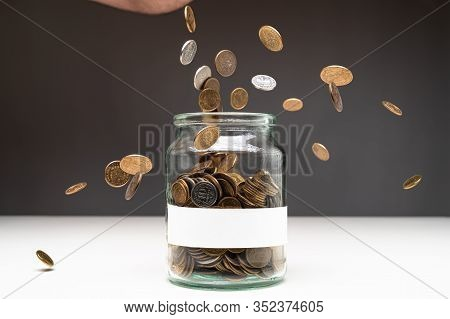 Coins In A Jar With Blank White Label. Money Falling From The Sky Above. Savings Abstract Concept. C