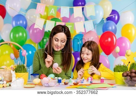Portrait Of Nice Attractive Lovely Creative Cheerful Cheery Girls Sisters Painting Eggs Creating Cra