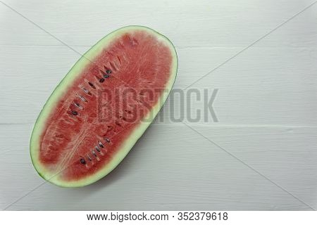 Close Up Over Head Of Fresh Watermelon Fruit Cut Slice Red Dissect Isolated On Wood Table White Back
