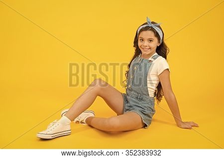 A Fashion Statement. Fashion Look Of Small Vogue Model. Adorable Girl In Fashion Wear On Yellow Back