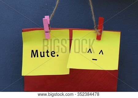 Inspirational Note Quote - Mute. With Mute Face Emoticon On Colorful Origami Paper Hanging On Wall W
