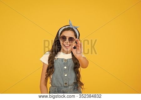 Alright. Summer Vacation Concept. Girl Long Curly Hair Sunglasses Tied Headscarf. Kids Clothes Bouti