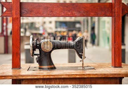Old Fashioned Vintage Sewing Machine On Noisy Street In Antwerp, Belgium. Popular Travel Tourism Des