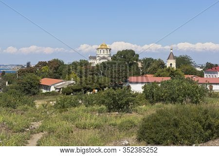 Sevastopol, Crimea, Russia - July 26, 2019: View Of The Vladimir Cathedral And The Temple Of The Sev