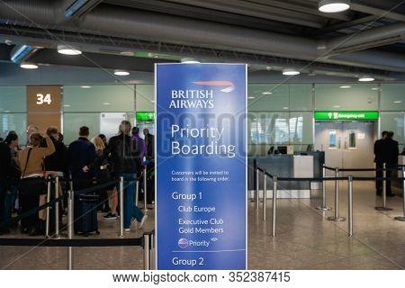 London, United Kingdom - February 2020: British Airways Boarding Gate And Passengers Waiting In Lond