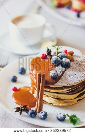 Plate Of Pancakes Dripping With Caramel With Cranberries And Blueberries. Shrovetide Maslenitsa Butt