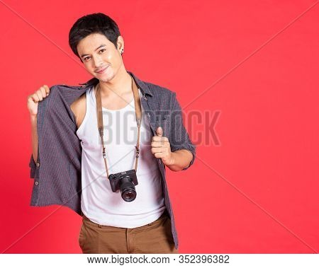 Happy Young Asian Hipster Photographer Man In Casual Fashion Using Vintage Camera Freedom Lifestyle